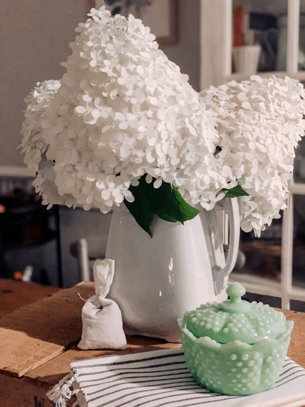 White Ironstone Pitcher with Florals.jpeg